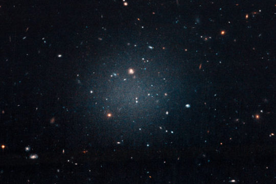 The first dark matter-less galaxy, NGC 1052-DF2
