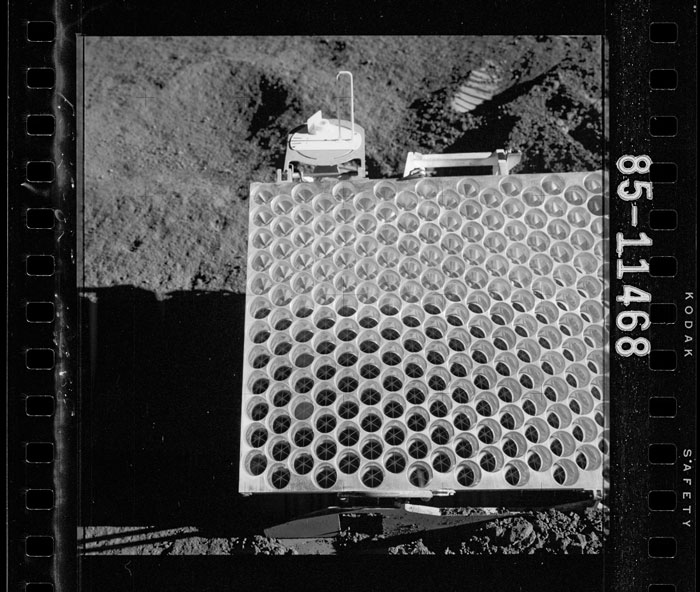 an image of a device resting on the lunar surface, that appears as a white square gridded with circles.