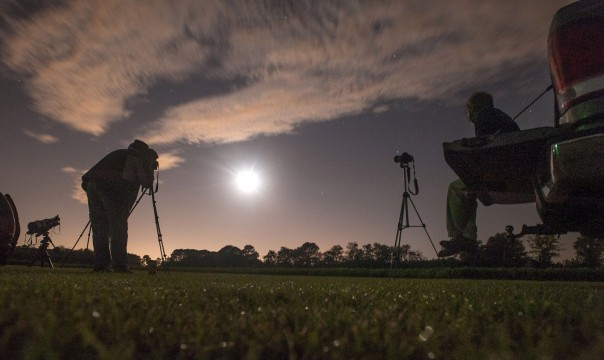 Photographers Chuck Vickers, right, and James Taylor photograph the total lunar eclipse Wednesday morning from a large field south of Wade, NC.
