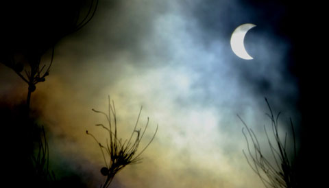 Partial solar eclipse through the clouds from Kenya