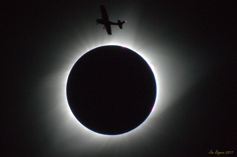 Eclipse silhouetting small plane. Salem, Oregon, 8/21/2017.