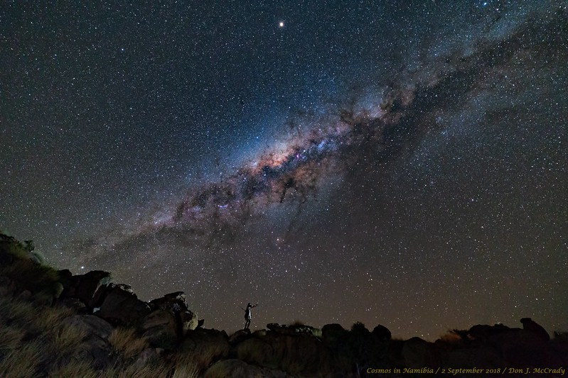 Stargazer standing beneath the Milky Way