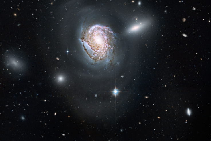 Spiral galaxy NGC 4911 against star field