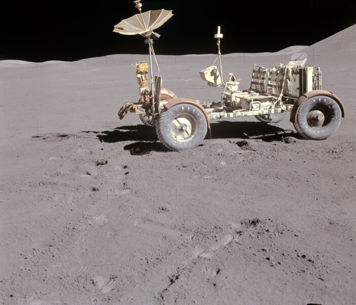 The lunar rover, an open vehicle with four wheels, two seat and a receiver that resembles an upturned umbrella