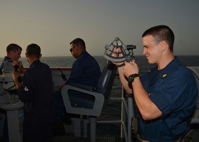 U.S. Navy officer using sextant at sea