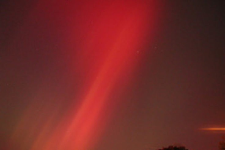 Aurora over Boston suburb