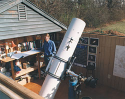 The author fights dew in his observatory in two ways: his 12½-inch reflector has an extra-long tube, and his roll-off roof hangs partway over his worktable, protecting charts and accessories from radiational cooling.