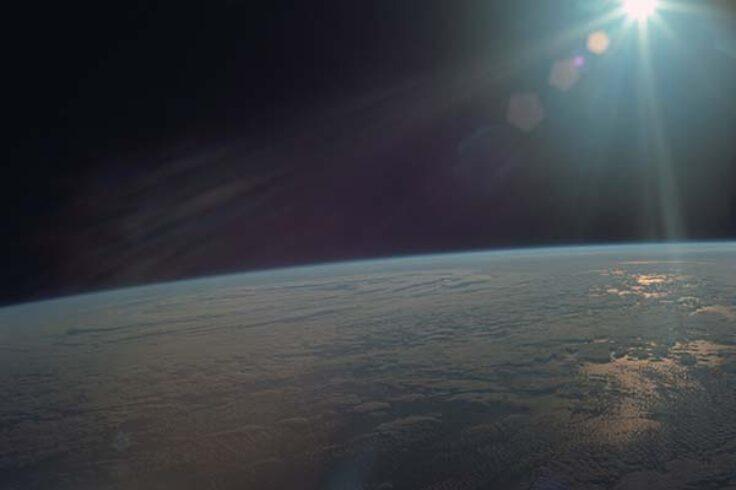 Apollo 11 photo of Earth with glare from Sun