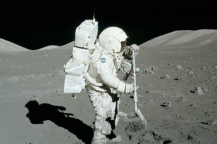 Astronaut collecting lunar soil