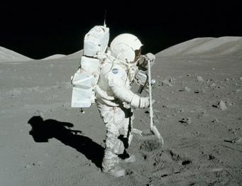 Astronaut collecting lunar soil