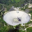 Arecibo 305 m radio telescope, located in a natural valley in Puerto Rico.NAIC