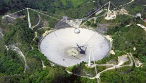 Arecibo 305 m radio telescope, located in a natural valley in Puerto Rico. NAIC