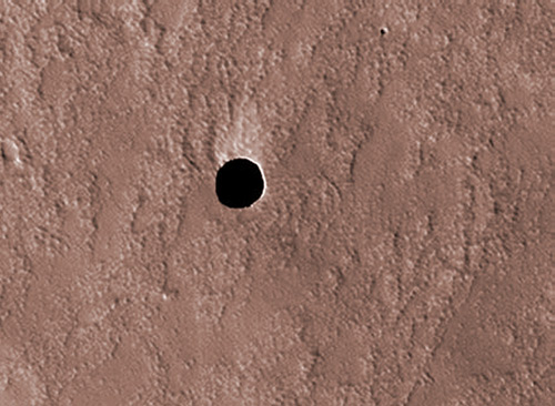 Dark hole on Arsia Mons