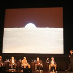 Lester Lyles, Kenneth Ford, Robert Zimmerman, Paul Spudis, and Steven Squyres (left to right) remained seated throughout the discussion, while Neil deGrasse Tyson paced back and forth.