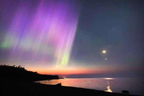 Even dawn couldn't put a stop to this auroral show.
