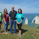 Texas State students Ava Pope, Laura Bright, and Hannah Reynolds stand with author Don Olson on the cliff high above the Jambourg beach to the southwest of Étretat. Visible in the background are the Needle and the Porte d'Aval, as seen from a perspective nearly opposite to that of Monet's sunset painting.