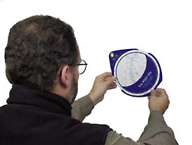 Holding a planisphere