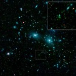 The newly discovered dwarf galaxies appear as faint green smudges in this false-color mosaic that combines visible-light data from the Sloan Digital Sky Survey (blue) with long- and short-wavelength infrared views (red and green, respectively) acquired by the Spitzer Space Telescope. Two large elliptical galaxies — NGC 4889 and 4874 — dominate the center of the cluster.