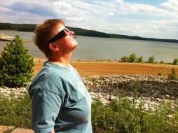 Viewing the sun through solar eclipse shades.