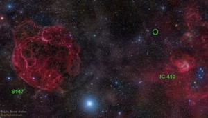 Optical sky image of the area in the constellation Auriga where the fast radio burst FRB 121102 has been detected. The position of the burst, between the old supernova remnant S147 (left) and the star formation region IC 410 (right) is marked with a green circle. The burst appears to originate from much deeper in space, far beyond our galaxy. Rogelio Bernal Andreo (DeepSkyColors.com)
