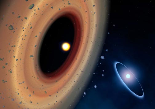 Artist's impression of the Fomalhaut system. The newly discovered comet belt around Fomalhaut C is shown to the left. The comet belt around Fomalhaut A is in the distance to the right. The belt around Fomalhaut A is offset slightly, a signature of the elliptical orbits in the belt, which may have been caused by past interactions with the star Fomalhaut C. Credit: Amanda Smith