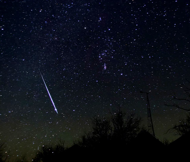 Geminid meteor crosses Orion