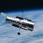 The Hubble Space Telescope floats away from the Space Shuttle Columbia after the last Hubble servicing mission in March 2002.