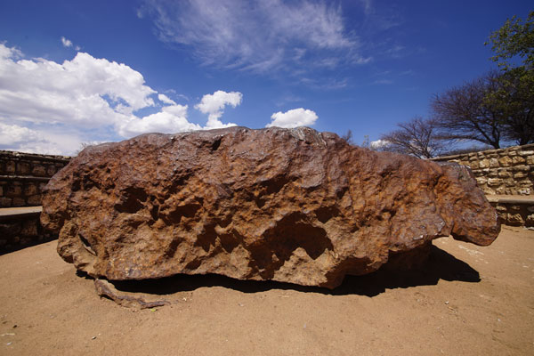 At over 60 tons, and measuring 2.7 meters across, the Hoba Meteorite near Grootfontein, Namibia, is the largest known space rock on the planet.