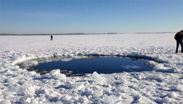 Ice hole in Lake Chebarkul