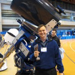 Scott Roberts, Meade Instruments Vice President of National Sales, shows off their new 20-inch RCX400 and mySKY hand-held planetarium unit.