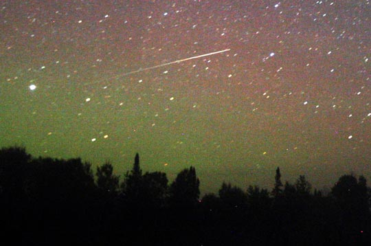 Meteor dusts a glowing sky