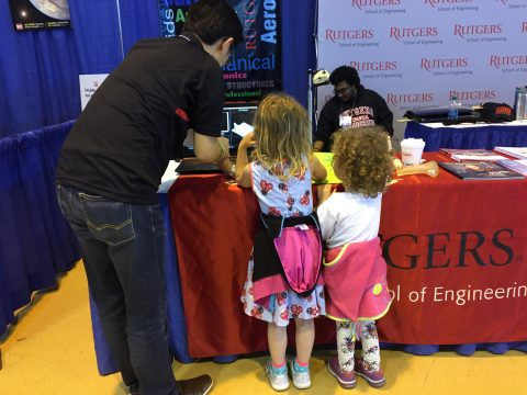 Two children inspect the Rutgers Engineering booth