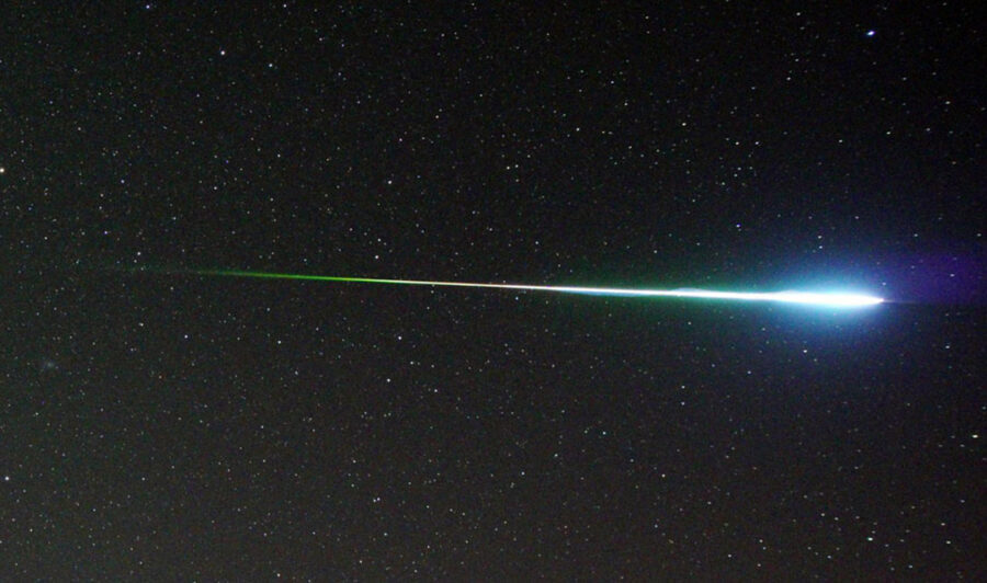 Colorful Perseid fireball shown in purple, blue, and green