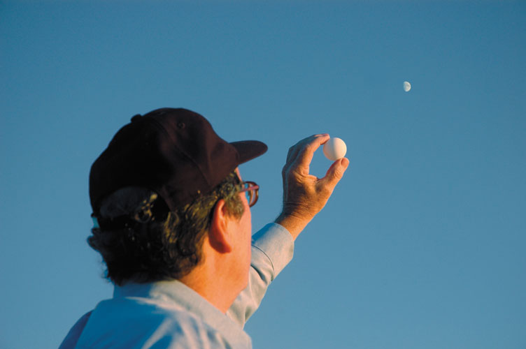 Holding a white ball at arm's length in the direction of the Moon shows how lunar phases depend on where the Moon is in the sky with respect to the Sun. S&T: J. Kelly Beatty