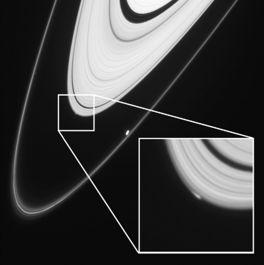 A close up of Saturn's A ring reveals a bright spot, likely due to a nearby small moon. Murray et al.