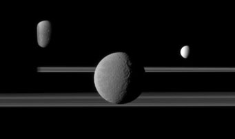 Saturn's rings and three moons