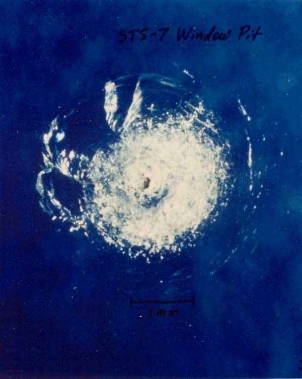 challenger micrometeoroid window crack