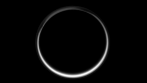 This celestial circle of light is produced by the glow of sunlight scattered through the periphery of Titan's atmosphere as the Sun is occulted by Titan. Image Credit: NASA / JPL / Space Science Institute