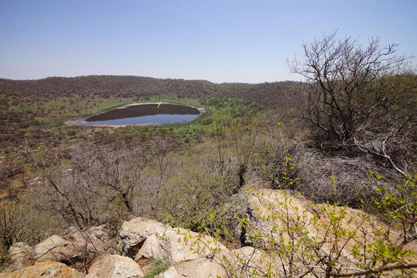 Standing on the rim of the 1.1-kilometer Tswaing crater, just north of Pretoria, provides a good view of the lake at the crater floor.