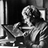 Annie Jump Cannon examines glass plate