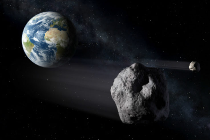 Illustration of asteroids passing Earth