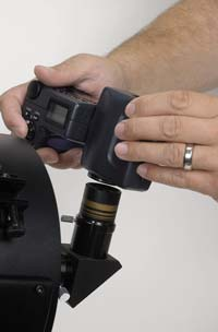 Digital camera for astrophotography held up to eyepiece