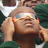 Tanzanian child views the Sun