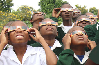 Tanzanian children view the Sun