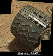 Image of tear in one of Curiosity's wheels taken on Dec. 22, 2013 NASA/JPL/MSSS/Ken Kremer -kenkremer.com/Marco Di Lorenzo