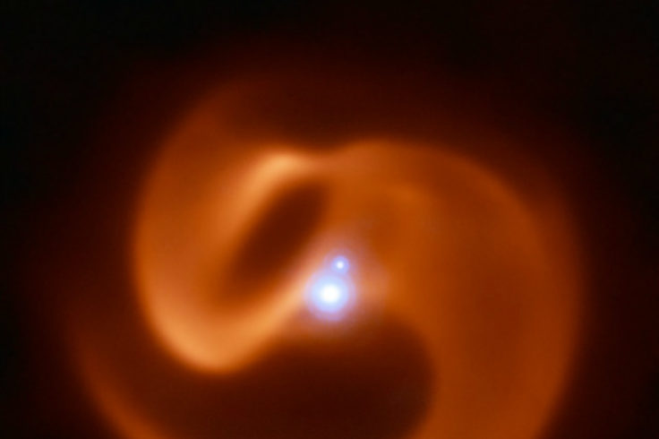 Image of a pinwheel of dust around a massive star