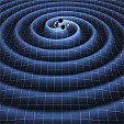 Gravitational waves produced by two orbiting black holes.K. Thorne (Caltech)/ T. Carnahan (NASA GSFC)