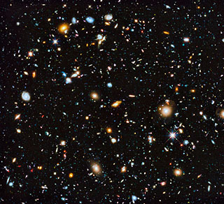 Smattering of distant galaxies imaged in Hubble's Ultra Deep Field Project.