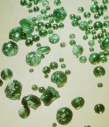 Green glass beads from the Moon