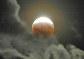 Partial lunar eclipse and clouds